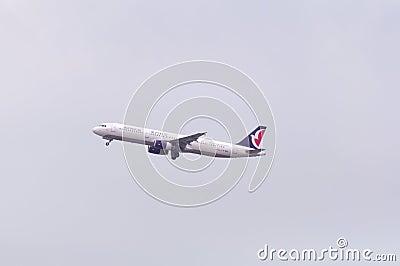 Air macau air plane in the sky Editorial Stock Photo