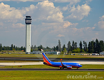 Air Traffic Control Tower and an Airplane