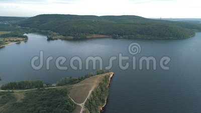 Air view of the Volga river and hills near the water. Aerial birds eye drone view from the cliffs stock footage