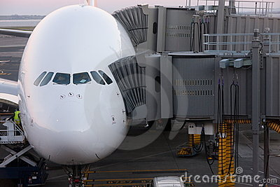Airbus A380 airliner docked for boarding.