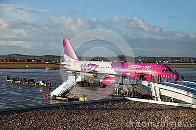 Aircraft at airport terminal jetty Editorial Photo
