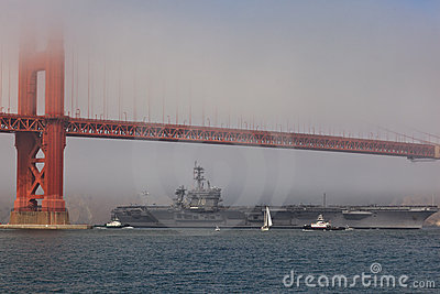 Aircraft carrier Carl Vinson at Golden Gate Bridge Editorial Image