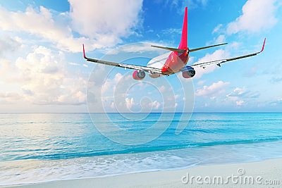 Aircraft flying over the beach