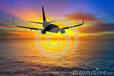 Aircraft flying at sunset