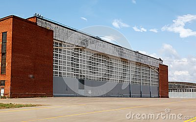 Aircraft hangar with blue sky