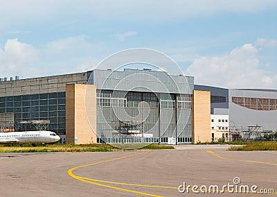 Aircraft hangar with blue sky