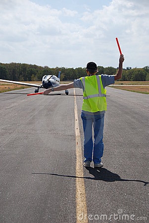 Aircraft Marshall Directs Airplane