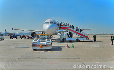 Aircraft and passengers Editorial Stock Photo