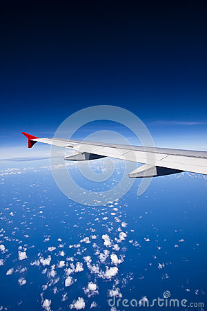 Aircraft wing on the clouds