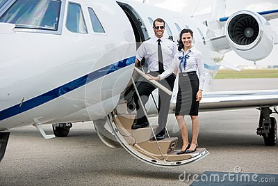 Airhostess And Pilot Standing On Private Jet s