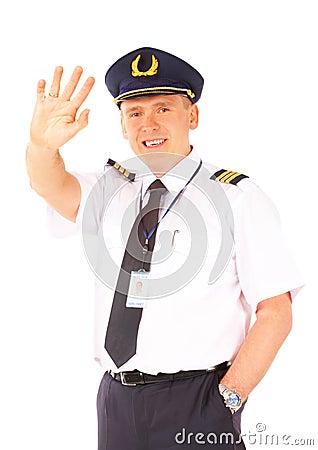 Airline pilot waving