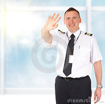 Airline pilot waving
