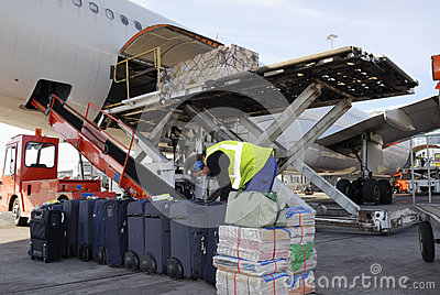 Airliner being loaded with luggage
