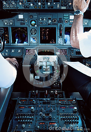 Airliner Cockpit with Pilots