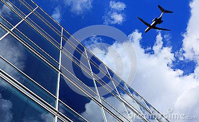 Airliner flying over office buildings