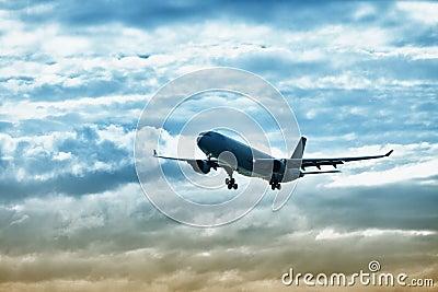Airliner landing on evening sky