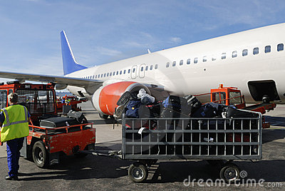 Airliner loaded with suitcases