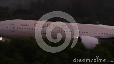 Airplane approaching at sunset backgfround stock footage