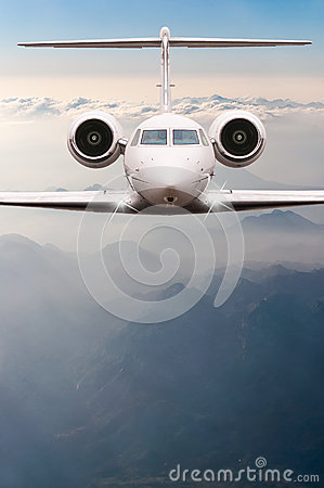 Free Airplane Fly Over Clouds And Alps Mountain On Sunset. Front View Of A Big Passenger Or Cargo Aircraft, Business Jet Stock Photography - 67927192
