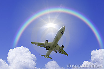 An airplane fly over the rainbow
