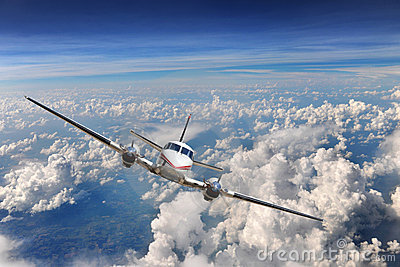 Airplane flying above the clouds royalty free stock photos image