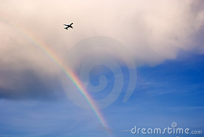 Airplane flying over rainbow