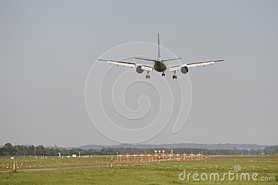 Airplane is landing at airport