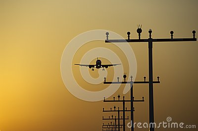 Airplane landing at frankfurt airport at sunrise