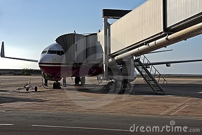 Airplane loading fuel and cargo in the airport