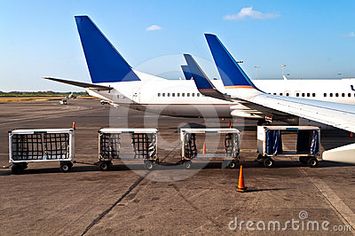 Airplane with luggage cars