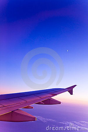Airplane and moon on gradient colors sky