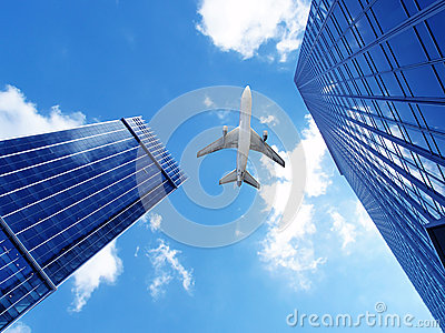 Airplane over office buildings.
