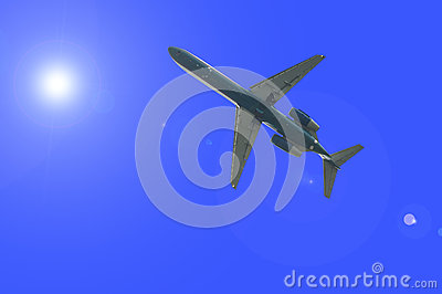 Airplane over the sun flare