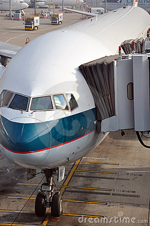Airplane and parking apron of Hongkong Airport Editorial Stock Image