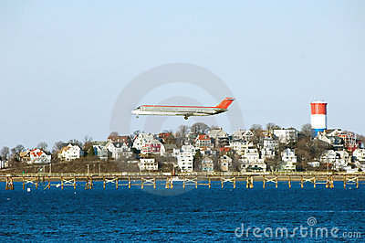 Airplane preparing for landing at Logan airport.