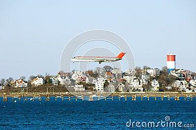 Airplane preparing for landing at Logan airport.