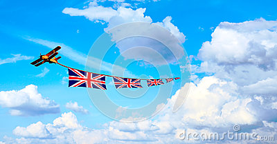 Airplane pulling British flags, union jack