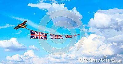 Airplane pulling British flags, union jack
