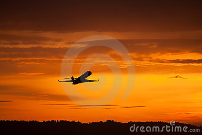 Airplane takeoff in sunset