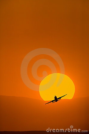 Airplane taking with bright orange sunrise