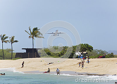 Airplane taking off over the beach