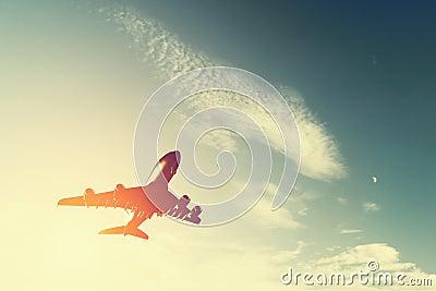 Airplane taking off at sunset.