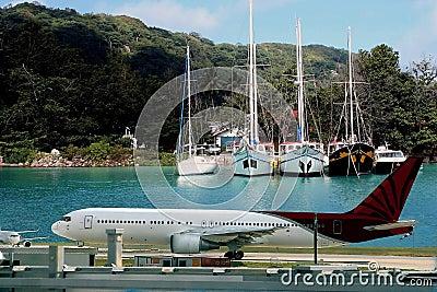 Airplane on tropical destination.