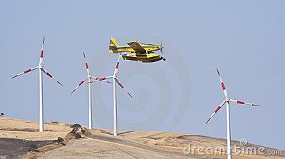 Airplane in wind farm Editorial Image