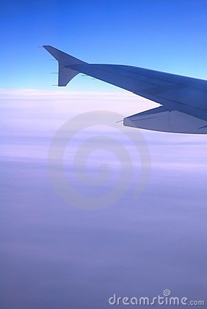 Airplane Wing Above Clouds