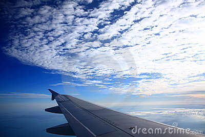 Airplane Wing & Blue Sky