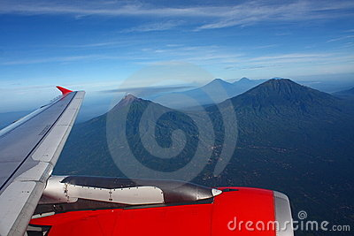 Airplane Wing Flying Above Mountains