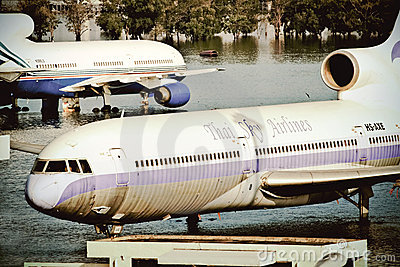 Airplanes drown in the water Editorial Stock Image