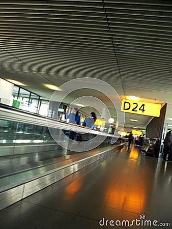 Airport interior walkway to Gate