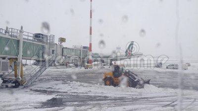 Airport. Snow Cleanup airport in Bucharest in December 2014 filmed by airplane window stock video